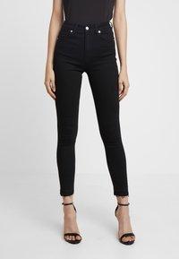NA-KD - HIGH WAIST OPEN HEM - Jeans Skinny Fit - black - 0