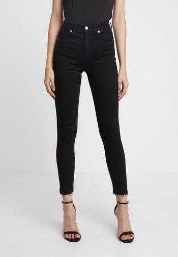 HIGH WAIST OPEN HEM - Jeans Skinny Fit - black