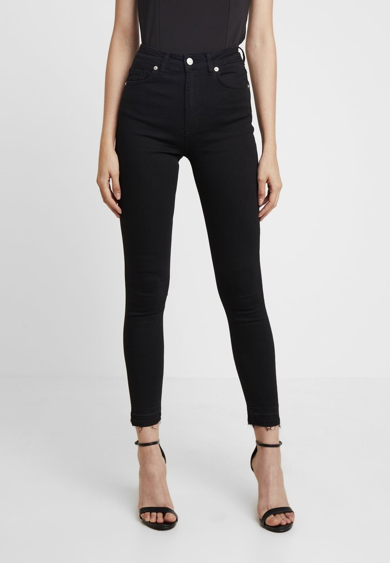 NA-KD - HIGH WAIST OPEN HEM - Jeans Skinny Fit - black