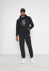 Common Kollectiv - FUTURE HOOD UNISEX  - Sweatshirt - black - 1