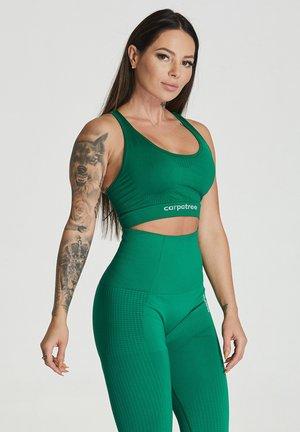 ESSENTIAL SEAMLESS - Sports bra - green