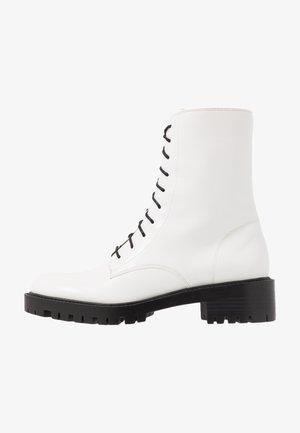 LEXI - Platform ankle boots - prestine