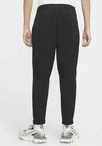 Nike Sportswear - Tracksuit bottoms - black/black - 2