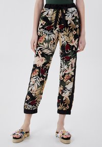 Liu Jo Jeans - Tracksuit bottoms - black with tropical print - 0