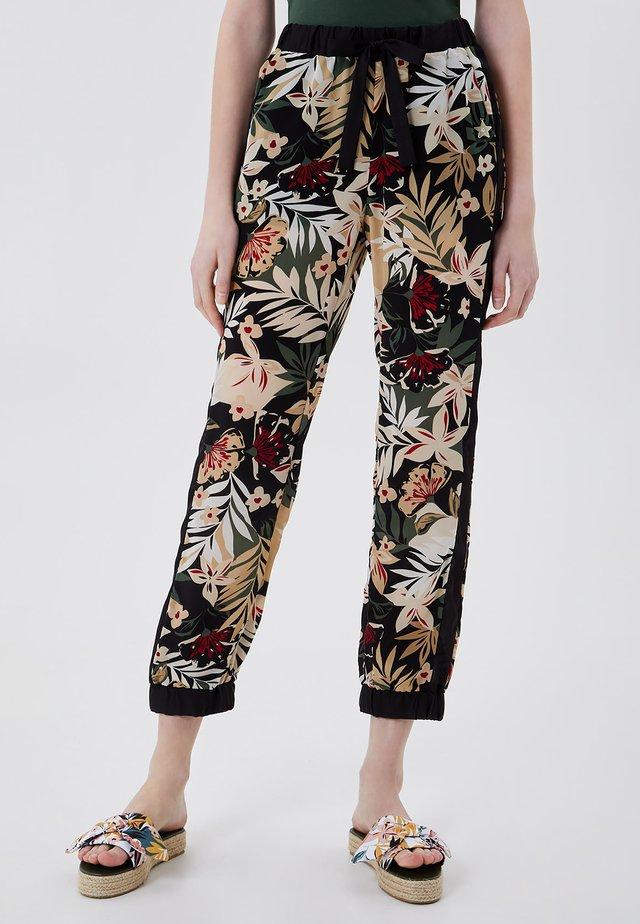 Pantalon de survêtement - black with tropical print