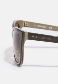 Calvin Klein - Sunglasses - dark brown/beige - 4
