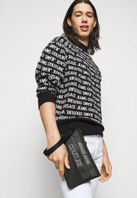 Versace Jeans Couture - UNISEX - Across body bag - black - 1