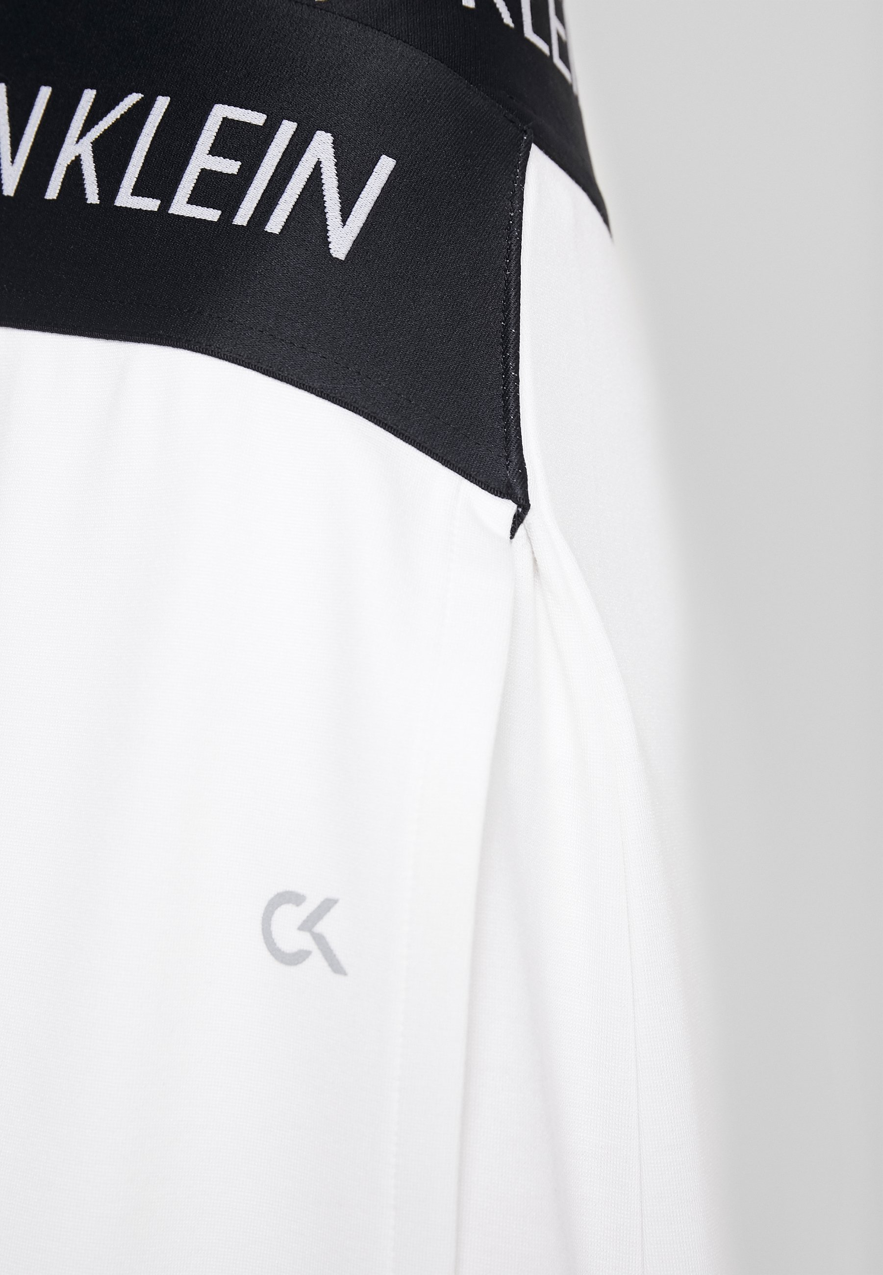 Online Women's Clothing Calvin Klein Performance ASYMMETRIC SKIRT Sports skirt white LpnU1Vh7f