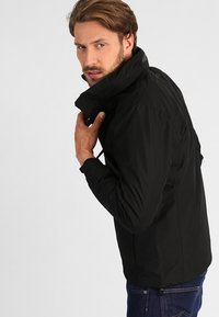 Helly Hansen - DUBLINER JACKET - Waterproof jacket - black - 3