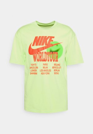 TEE WORLD TOUR - Print T-shirt - light liquid lime