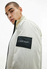Calvin Klein - CRINKLE EASY  - Light jacket - off-white - 6