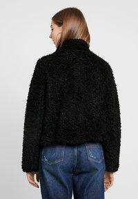 Vero Moda - VMVIRIGINIATEDDY HIGH NECK - Winter jacket - black - 2