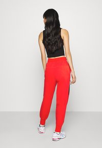 Nike Sportswear - Tracksuit bottoms - chile red/black - 2