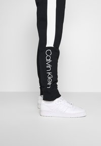 Calvin Klein - OGO STRIPE  - Trainingsbroek - black - 4