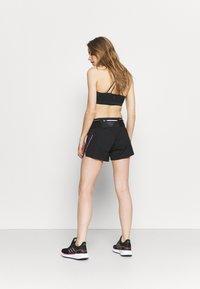 Dynafit - DNA SPLIT SHORTS - Sports shorts - black out - 2