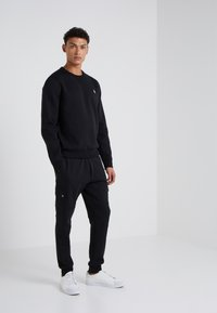 Polo Ralph Lauren - DOUBLE TECH - Pantalon de survêtement - black - 1