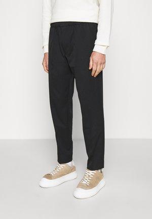 ELASTICATED TROUSER - Trousers - black