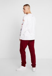 adidas Originals - TREFOIL PANT UNISEX - Tracksuit bottoms - collegiate burgundy - 2