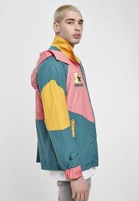Starter - MULTICOLORED LOGO - Summer jacket - green/yellow/pink - 4