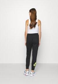 Nike Sportswear - AIR PANT   - Tracksuit bottoms - black - 2
