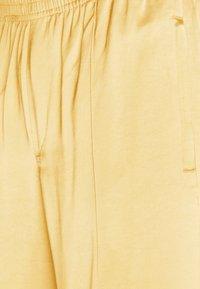 Weekday - KEN STAIN TRACK PANTS UNISEX - Trousers - beige - 2