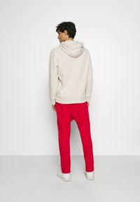 Schott - PAUL - Tracksuit bottoms - red - 2