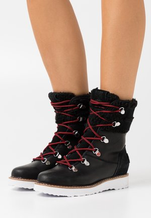 BRANDI - Snowboot/Winterstiefel - black
