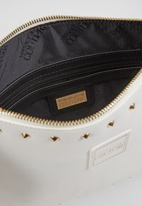 Versace Jeans Couture - STUDDED POUCH ON STRAP - Clutch - white - 5