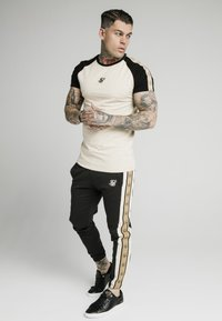 SIKSILK - PREMIUM TAPE TRACK PANT - Tracksuit bottoms - black/off white - 1