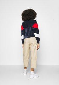 Fila - BELLINI CROPPED HALF ZIP - Sweatshirt - black iris/true red/bright white - 2