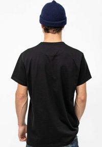 Butcher of Blue - T-shirt basic - off black - 1
