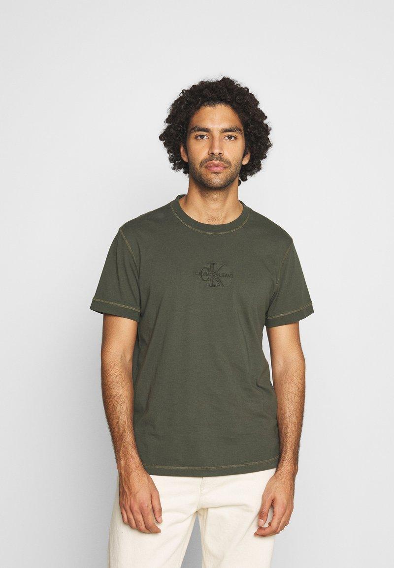 Calvin Klein Jeans - ACID WASH TEE - T-shirt basic - deep depths