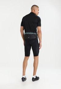 Craft - RISE SHORTS - Sports shorts - black - 2