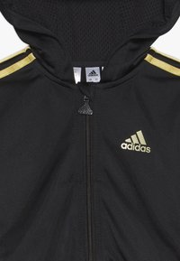 adidas Performance - SHINY FULL ZIP HOODED TRACKSUIT BABY SET - Verryttelypuku - black/gold - 4