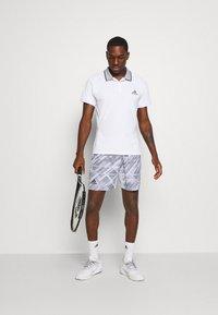 adidas Performance - PRINTED SHORT - Sports shorts - grey - 1