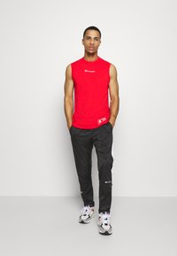Champion - LEGACY PANTS - Jogginghose - black - 1
