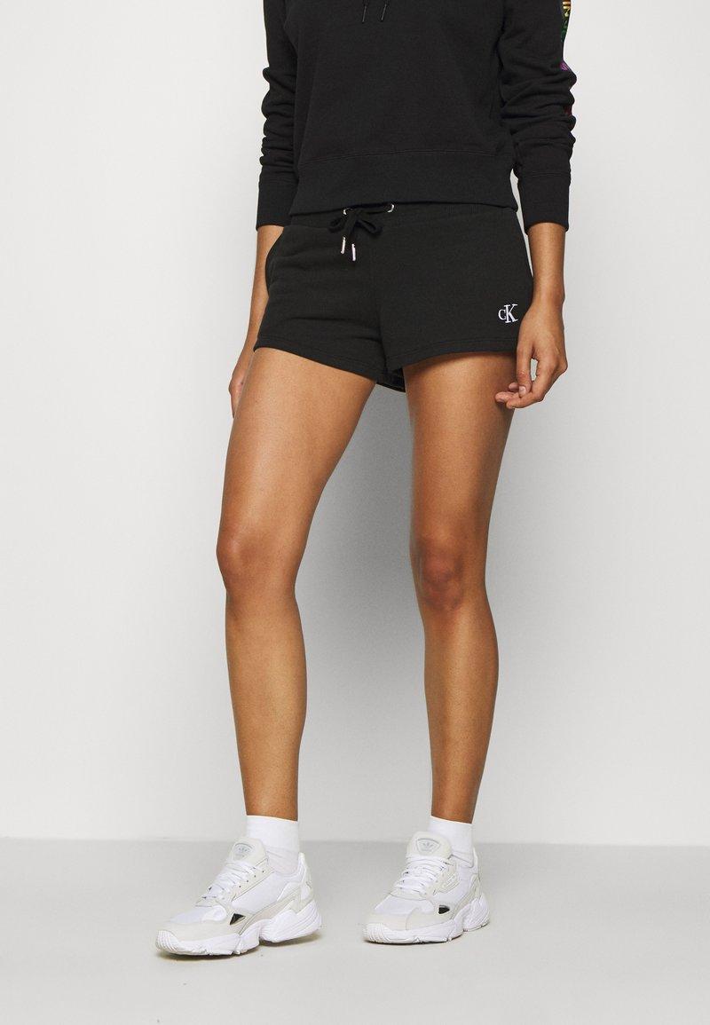 Calvin Klein Jeans - BACK LOGO - Tracksuit bottoms - black