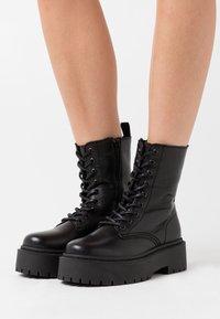 Bianco - Platform ankle boots - black - 0