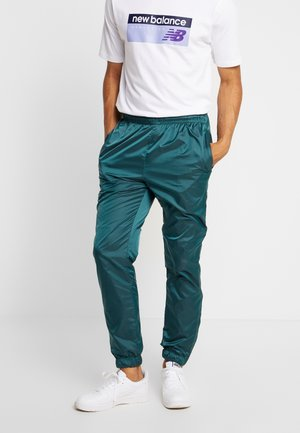 TRACK PANTS - Tracksuit bottoms - bottlegreen