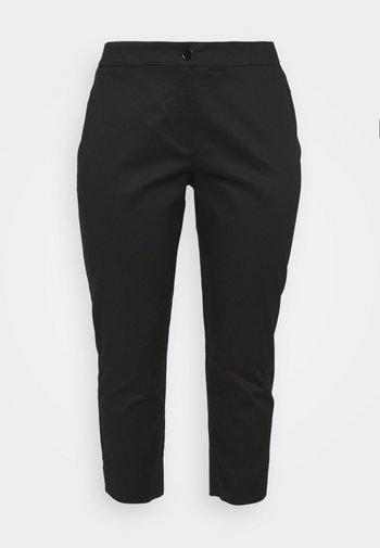 RITMO - Trousers - black