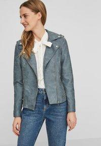 Vero Moda - VMWORLD SHORT - Faux leather jacket - dark blue - 0