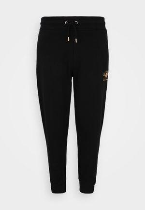 PLUS ARCHIVE SHIELD PANTS - Teplákové kalhoty - black