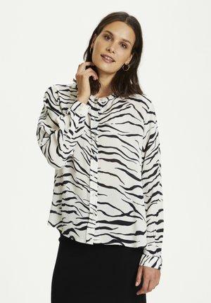 KAOTELIA - Blouse - black  chalk zebra print