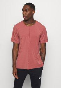 Nike Performance - DRY YOGA - Camiseta básica - claystone red/black - 0