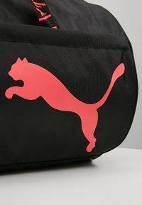 Puma - ESS BARREL BAG - Sports bag - black/pink alert - 7