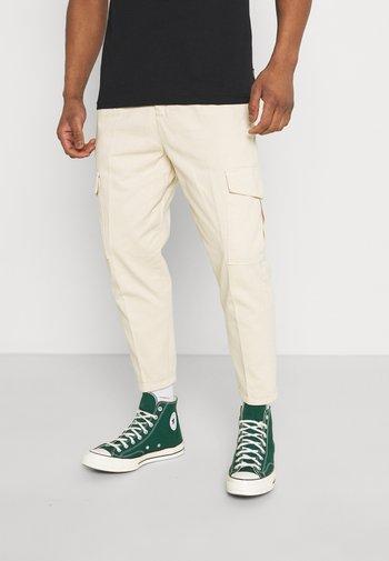 JACOB PANTS - Cargo trousers - sandshell