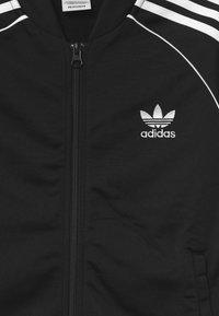 adidas Originals - TRACK UNISEX - Veste de survêtement - black/white - 2