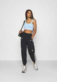 adidas Originals - TRACK PANTS - Tracksuit bottoms - black - 1