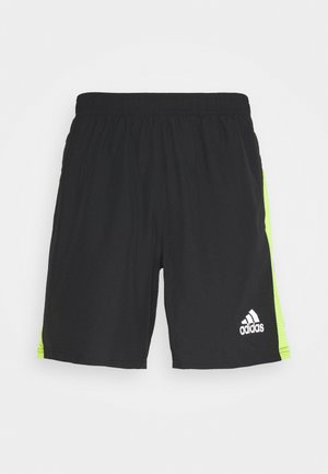 OWN THE RUN - kurze Sporthose - black/signal green