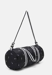 Nike Sportswear - HERITAGE DUFF - Sports bag - black/black/white - 1